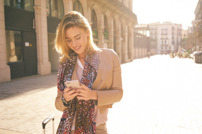 It's Facebook's World and We're All Living In It (Thinks Out Loud): Woman using social media on mobile phone
