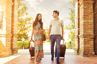 8 Extraordinary Insights into Hospitality Marketing and Distribution: Image of couple checking into hotel