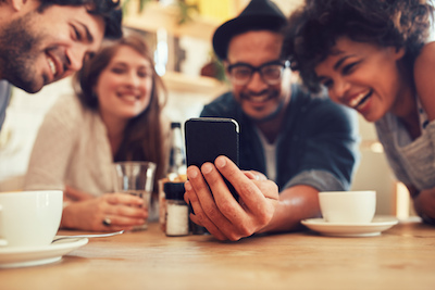 The Key E-commerce And Digital Strategy Trends For 2018: Young people browsing on mobile